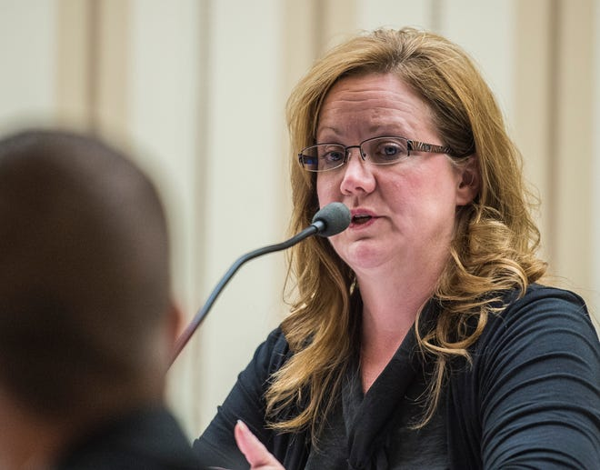 Council member Misty Hollis asks city attorney AJ Sickmann a question during a Richmond Common Council meeting at the city's municipal building on Monday, Aug. 20, 2018.