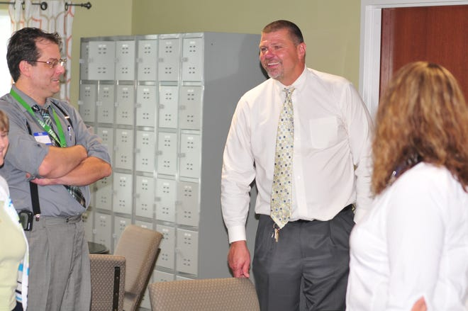 Terry Suttle, the director of labor relations for Recovery Works Cambridge City, talks to some of the addiction-treatment center's guests during a Tuesday open house.