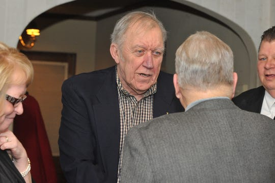 Inductee Bob Van Pelt is greeted by guests at Forest Hills Country Club during the Indiana Football Hall of Fame banquet Saturday, March 3, 2012.