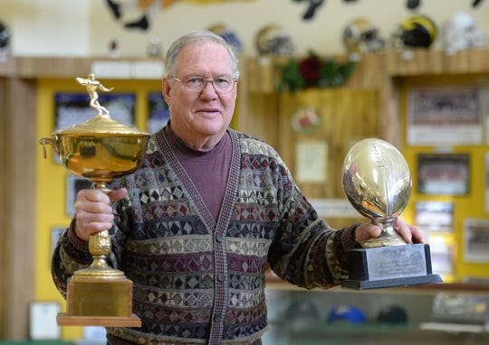 Paul Flatley holds two rookie of the year trophies inside the Indiana Football Hall of Fame, he received both after his first year playing football in the NFL for the Minnesota Vikings. Flatley started as a running back, switched to quarterback his senior year at Richmond and became a successful wide receiver in college and the NFL.