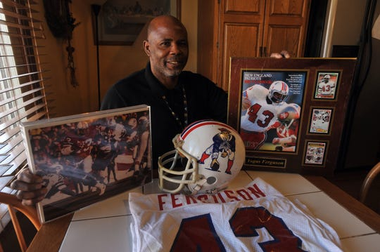 Vagas Ferguson with New England Patriots memorabilia from his playing days in the NFL.