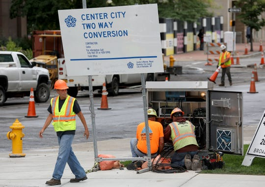Cross walk and stop lights are timed at a junction box at Clinton Ave. and Broad St. in preparation for the two way conversion of traffic on Clinton Ave.