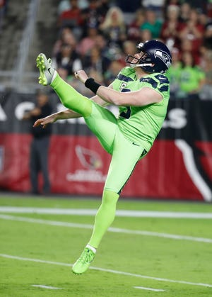 Seattle Seahawks punter Jon Ryan (9) during an NFL football game against the Arizona Cardinals, Thursday, Nov. 9, 2017, in Glendale, Arizona. Ryan, who was released Monday, signed a one-year deal with the Buffalo Bills on Tuesday.