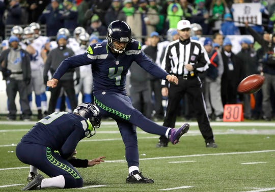 Seattle Seahawks kicker Steven Hauschka (4) kicks as punter Jon Ryan holds during an NFC wild card playoff game against the Detroit Lions. The two have been reunited in Buffalo with the Bills, who signed Hauschka last year and Ryan on Tuesday.