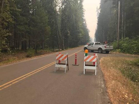 Roads have been closed around Cougar Reservoir due to the new fire.
