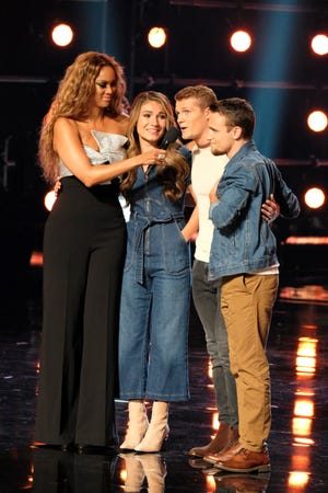 """AMERICA'S GOT TALENT -- """"Live Quarter Finals Results 1"""" Episode 1312 -- Pictured: (l-r) Tyra Banks, We Three -- (Photo by: Justin Lubin/NBC)"""