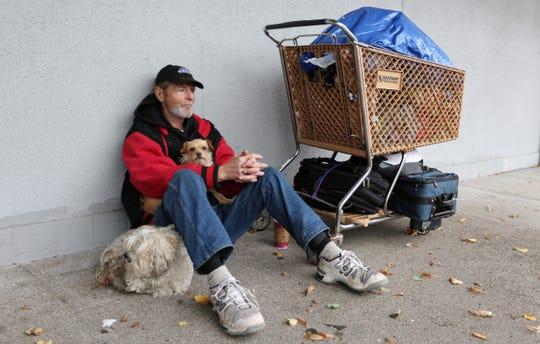 Steven Harrington, a homeless veteran, finds shelter from the rain under an awning in downtown Salem Oct. 16, 2016.