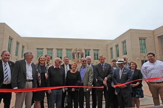 Monterey County District Attorney Dean Flippo conducts a ribbon cutting with other Monterey County leaders for the re-opening of the East West Wing.
