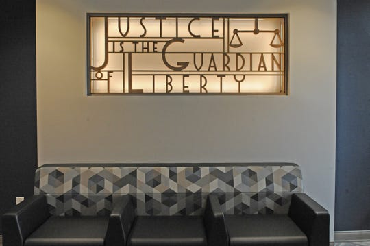 """A saved art piece reading """"Justice is the Guardian of Liberty"""" greets visitors to the new Monterey County District Attorney's Office in the newly-re-opened East West Wing."""