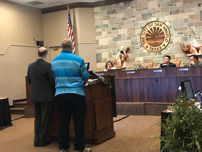 A concerned citizen presents a property damage problem to the city council at a meeting Tuesday, Aug. 21, 2018 at McNease Convention Center.
