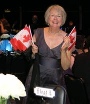 Justinian Krewe Member Jane Hubbard's float is Canadian-themed, so she brought flags to gussy up her table at the Royalty Coronation.