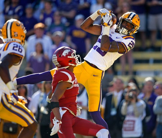 "LSU cornerback Andraez ""Greedy"" Williams (29) pulls in an interception against Arkansas in Baton Rouge, La., in 2017."