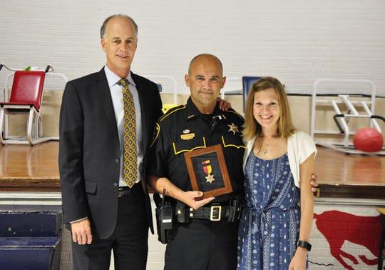Bossier Parish Sheriff presented the Star of Valor Award to Deputy Chris Slopak on Monday. Slopak performed the Heimlich Maneuver on kindergarten teacher Lindsay Burns after she ran into the hallway choking.