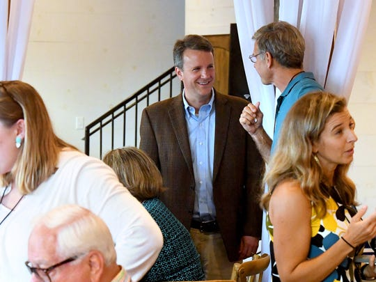 Del. Ben Cline, Republican nominee for the 6th district of Virginia congressional seat, stops for conversation as he mingles with the crowd at the Greater Augusta Regional Chamber of Commerce's Pig Pickin' & Politickin' 2018 at Valley Pike Farm Market in Weyers Cave on Tuesday, August 21, 2018.