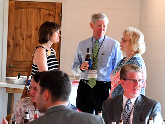 Del. Steve Landes shares conversation with others in attendance at the Greater Augusta Regional Chamber of Commerce's Pig Pickin' & Politickin' 2018 at Valley Pike Farm Market in Weyers Cave on Tuesday, August 21, 2018.