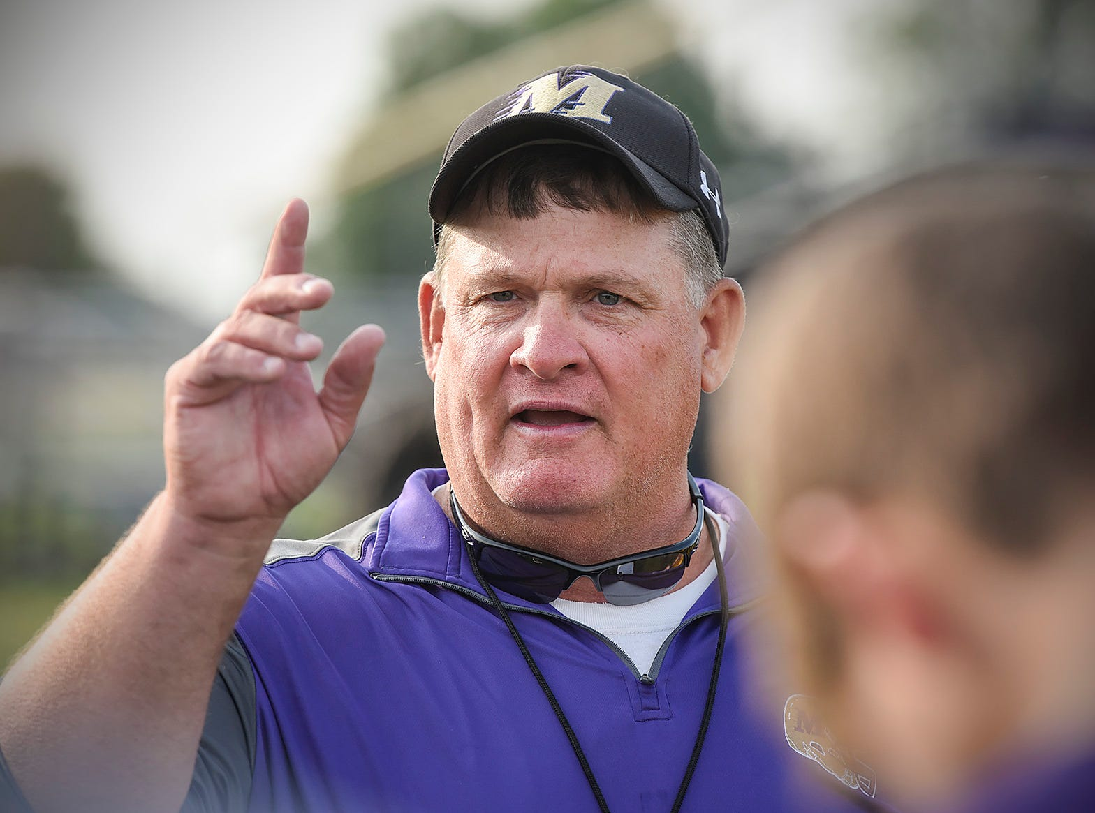 Melrose coach Chuck Noll works with players Wednesday, Aug. 15, during practice.