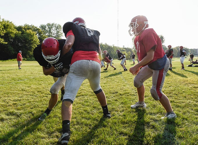 Milaca players work on blocking during practice Thursday, Aug. 16, in Milaca.