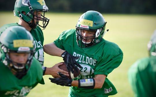 Josh Kranz takes a handoff during practice Thursday, Aug. 16, at Paynesville High School.