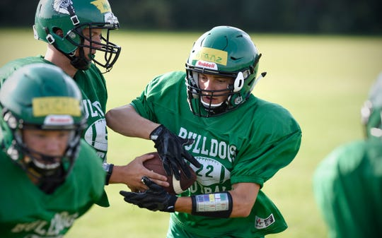 Josh Kranz takes a handoff during practice Thursday, Aug. 16, at Paynesville High School.