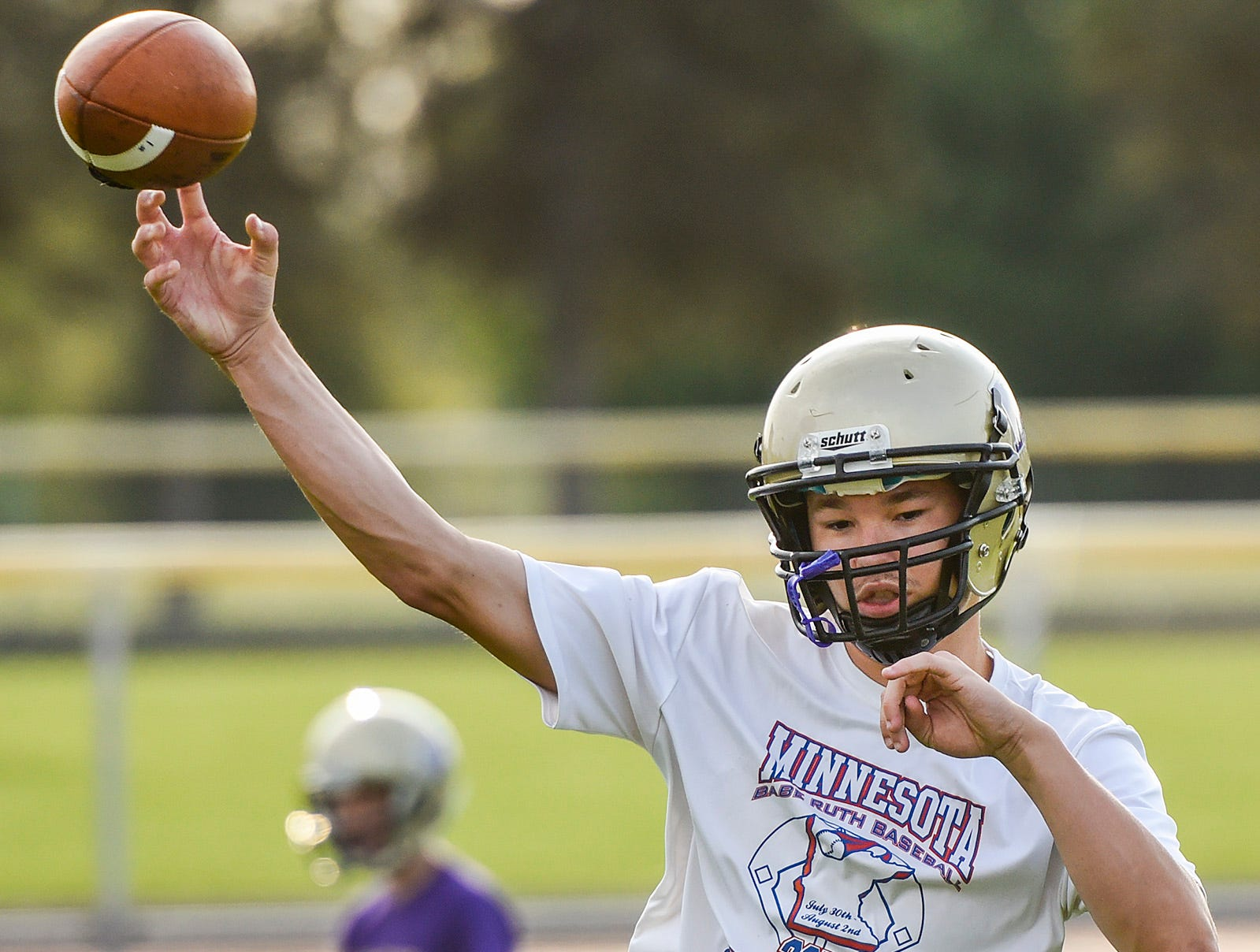 Melrose's quarterback Reegan Nelson throws to a receiver Wednesday, Aug. 15, during practice.