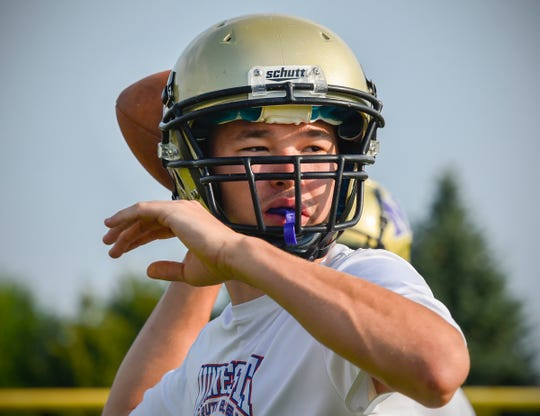 Melrose quarterback Reegan Nelson drops back to throw Wednesday, Aug. 15, during practice.