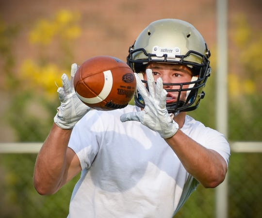 Melrose's Adam Helmin catches a pass Wednesday, Aug. 15, during practice.