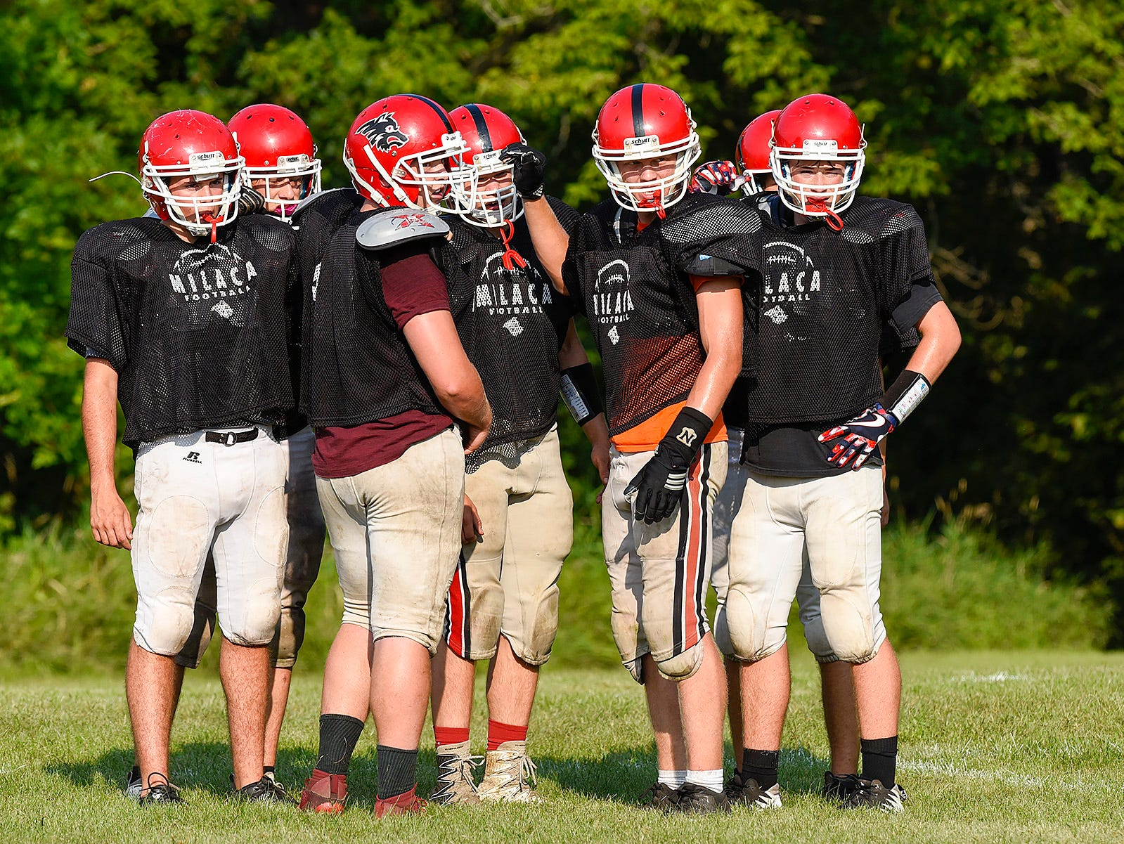 Milaca players watch for the next play to be called during practice Thursday, Aug. 16, in Milaca.