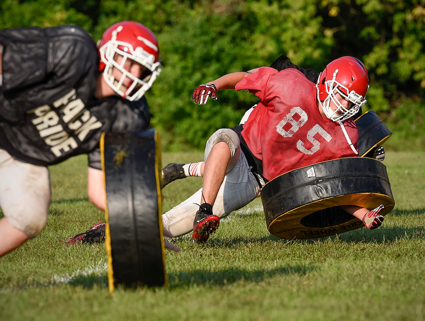 Milaca players work with rolling tackle wheels during practice Thursday, Aug. 16, in Milaca.