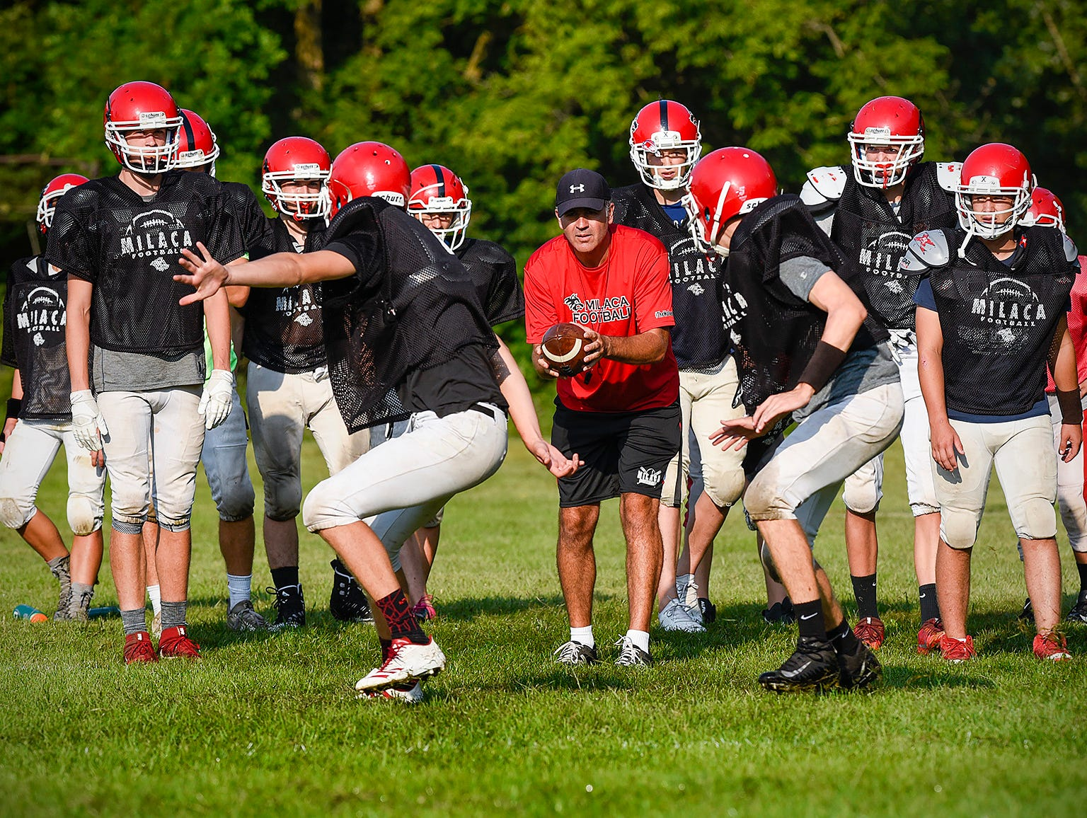 Milaca players go through a footwork drill during practice Thursday, Aug. 16, in Milaca.