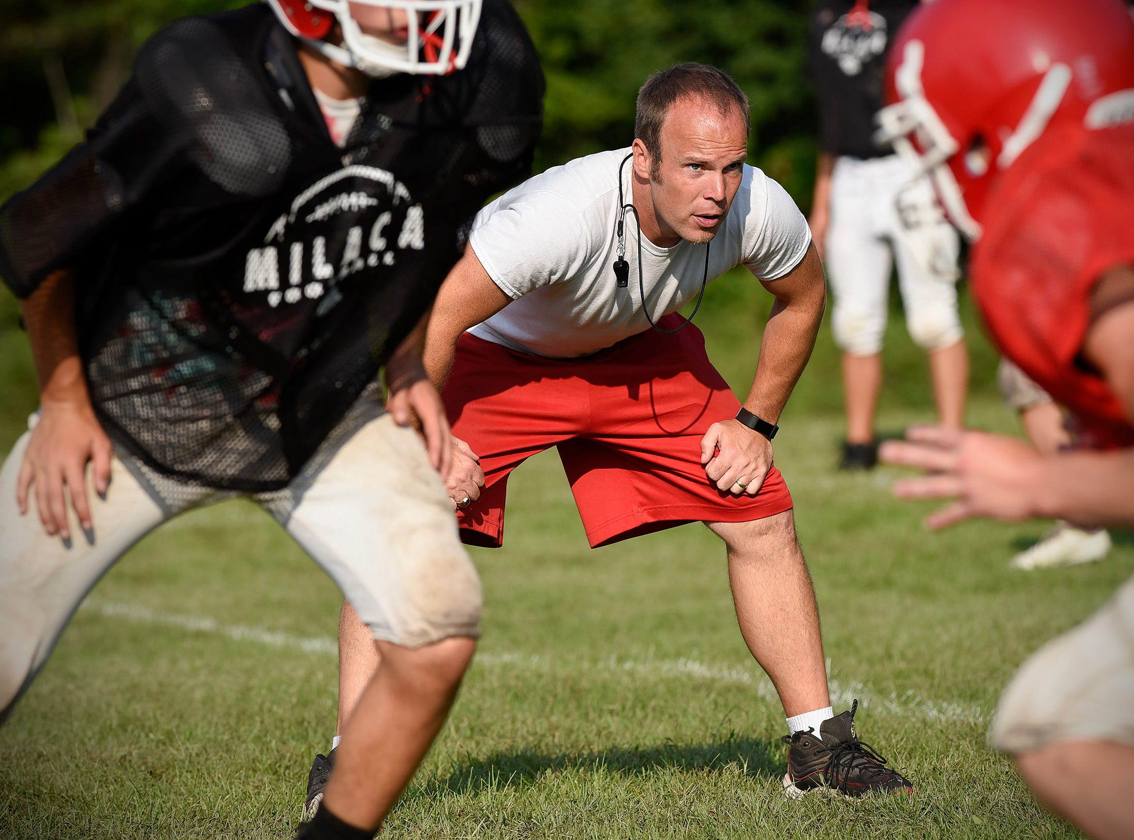 Milaca coach Kevin Kevin Armbrust watches a play during practice Thursday, Aug. 16, in Milaca.