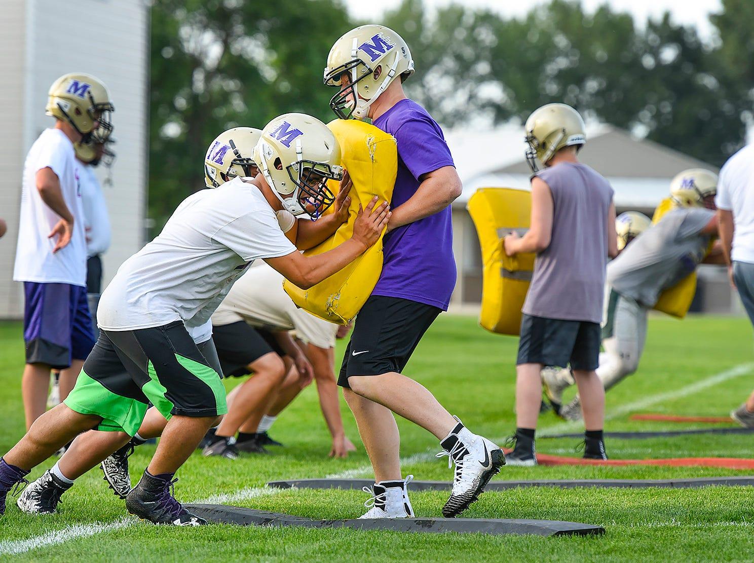 Melrose lineman work on blocking Wednesday, Aug. 15, during practice.