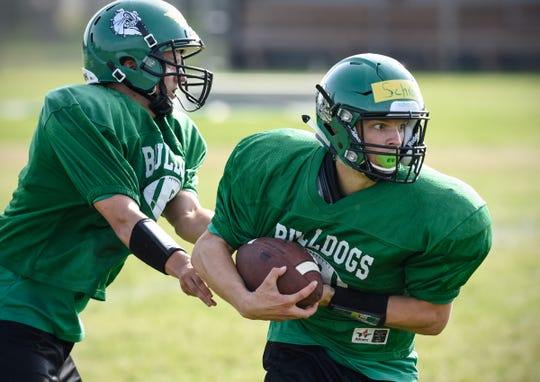 Zach Schroeder concentrates on the defense while running a drill during practice Thursday, Aug. 16, at Paynesville High School.