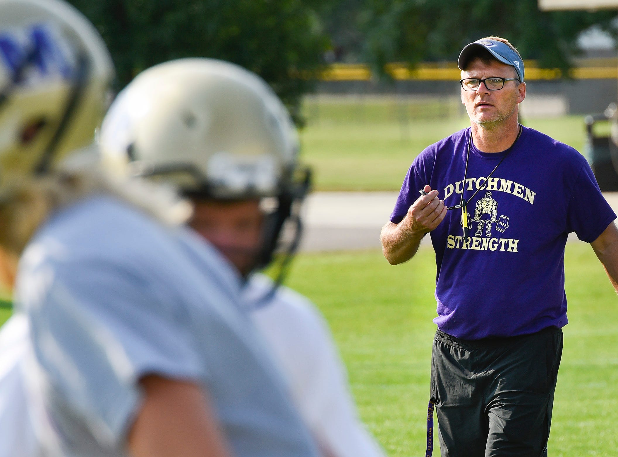 Melrose coach Vaughn Glasener watches a play from the backfield Wednesday, Aug. 15, during practice.