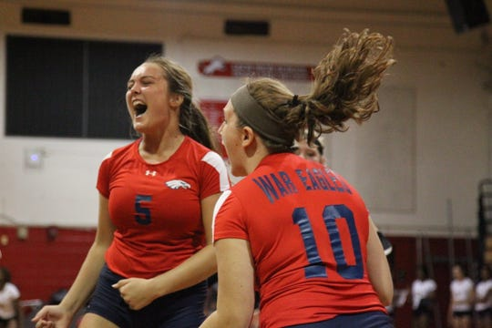 Wakulla's Melanie Oglesby (5) reacts to scoring a point during Saturday's preseason volleyball classic at Leon.