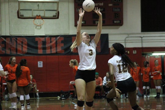 Florida High's Carlee Allbaugh sets a ball during Saturday's preseason volleyball classic at Leon.