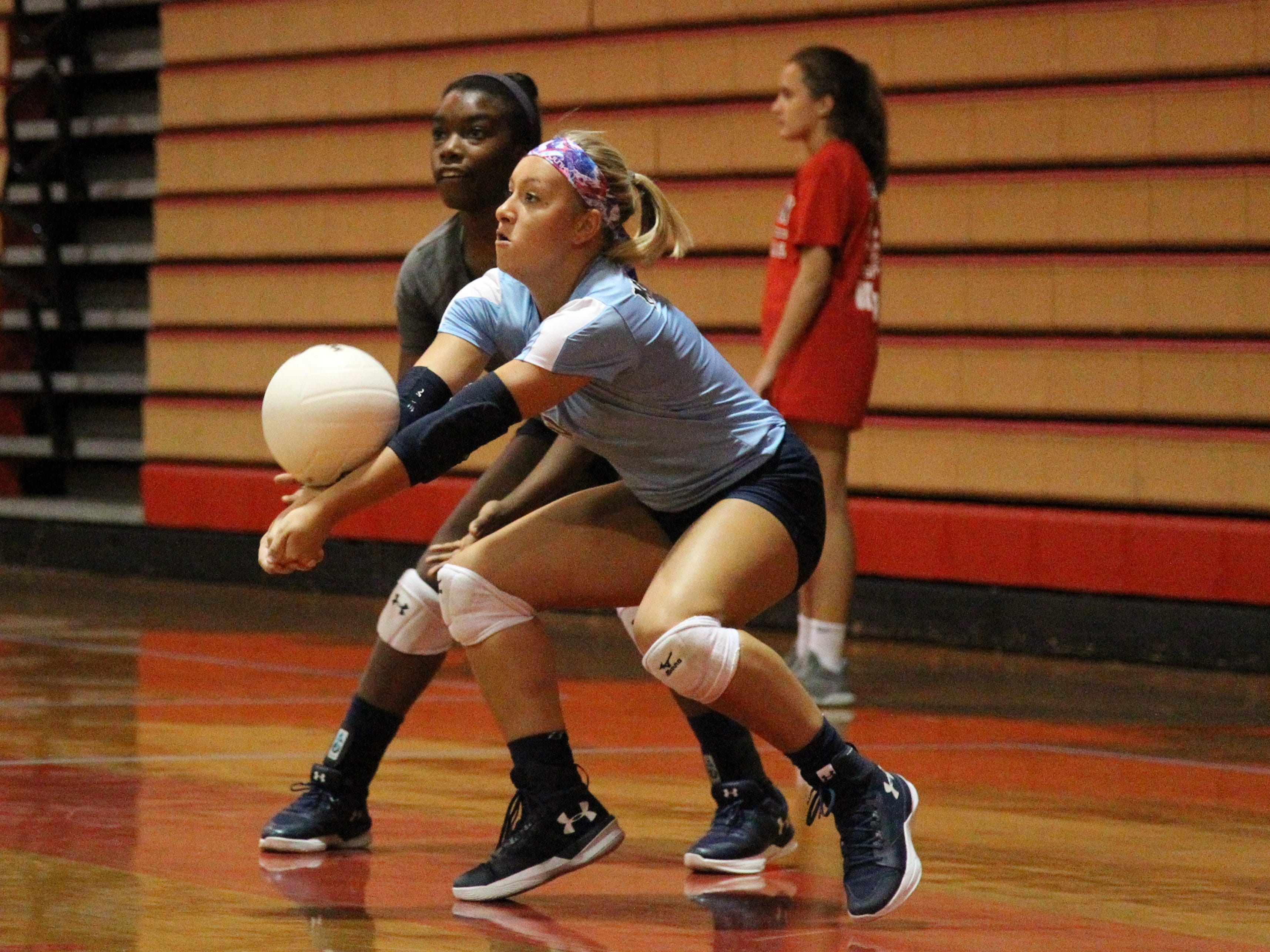Maclay's Addyson Lewis digs a serve during Saturday's preseason volleyball classic at Leon.