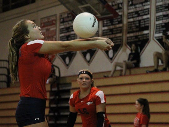 Wakulla's Melanie Oglesby sets a ball during Saturday's preseason volleyball classic at Leon.