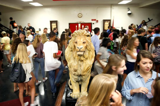 Leon High School students congregate in the front entrance near their school mascot. Parents of students at Leon and other top performing Leon County Schools, have become more creative in an effort to enroll their children in a school they aren't zoned for.