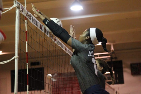 Maclay's Isabella Choice tries for a block during Saturday's preseason volleyball classic at Leon.