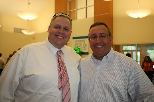 Kevin Youngblood and Steve Swindler at the Aug. 7 dedication of the David Cardno Father & Child Resource Center.