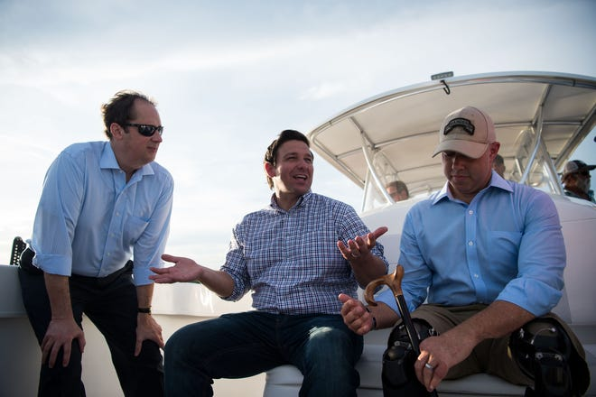 While campaigning for the governor's seat, U.S. Rep. Ron DeSantis, center, took a boat ride out of Stuart accompanied by Florida Senate President Joe Negron of Stuart, left, and U.S. Rep. Brian Mast of Palm City on Monday, Aug. 20, 2018, to see and discuss the algae crisis in the St. Lucie River.