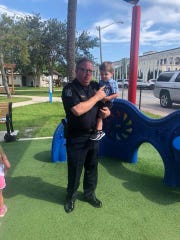 """Stuart's interim Police Chief Joseph Tumminelli stops at a playground for a  """"pop-up"""" event in summer 2018."""