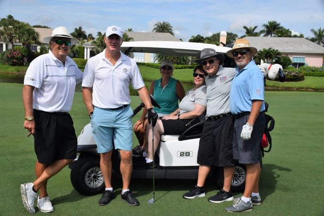 John Vetter, left, Kevin Flood, Lisa Coburn, Heather Cooley, Russ Cooley and sponsor Michael Coburn at the Women's Refuge annual golf tournament.