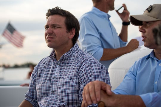 Then-gubernatorial candidate Ron DeSantis and Brian Mast take a boat ride out of Stuart, accompanied by Florida Sen. Joe Negron and other stakeholders, on Monday, Aug. 20, 2018.