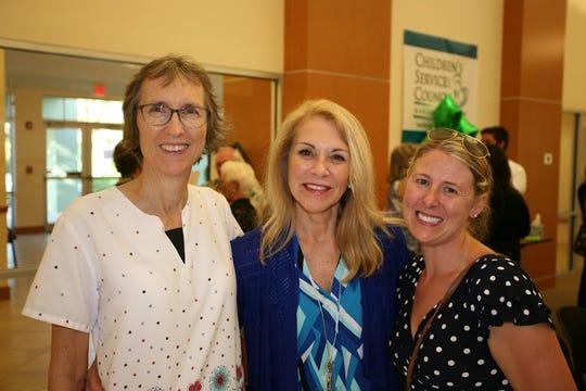 Cynthia Roderick, left, Carolann Wegener and Jennifer Furtwangler at the Aug.7 dedication of the David Cardno Father & Child Resource Center.