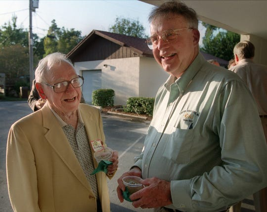 Marvin Center, right, whose great-grandfahter R.D. Carter founded the Vero Beach engineering firm Carter Associates, talks with retired Circuit Court Judge David Smith at the firm's 90th anniversary party in 2001.