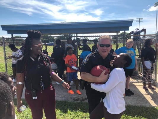 Stuart Interim Police Chief Joseph Tumminelli playing with children during one of his pop-up events this summer