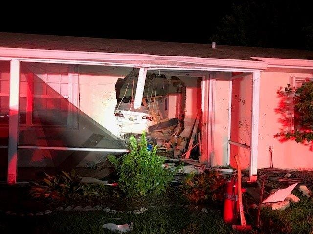 A man is accused of driving his car through a family's home Monday night, officers said.