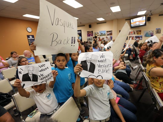 Paul Moreno Elementary School students on Monday urge the EPISD board to return former Principal Fernando Vasquez to the school.