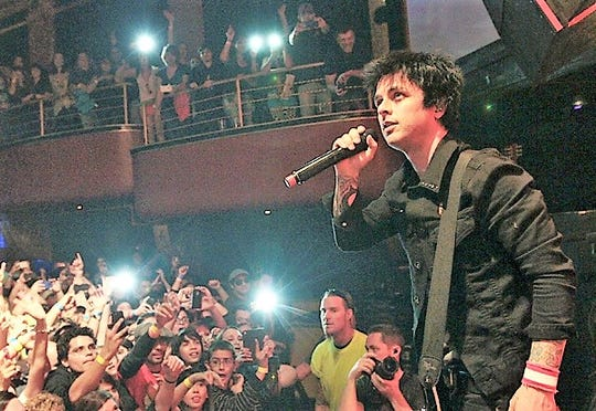 The band Green Day, including lead singer Billie Joe Armstrong, performed to a packed house at a 2013 concert at Tricky Falls in Downtown El Paso.